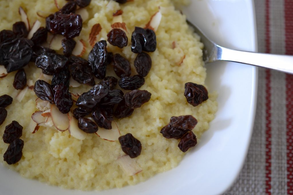 Egyptian breakfast couscous topped with dried fruit in a bowl