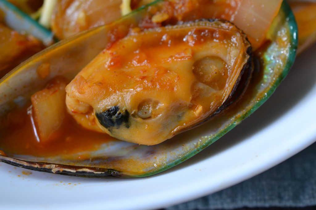 Close up of a cooked spicy mussel.
