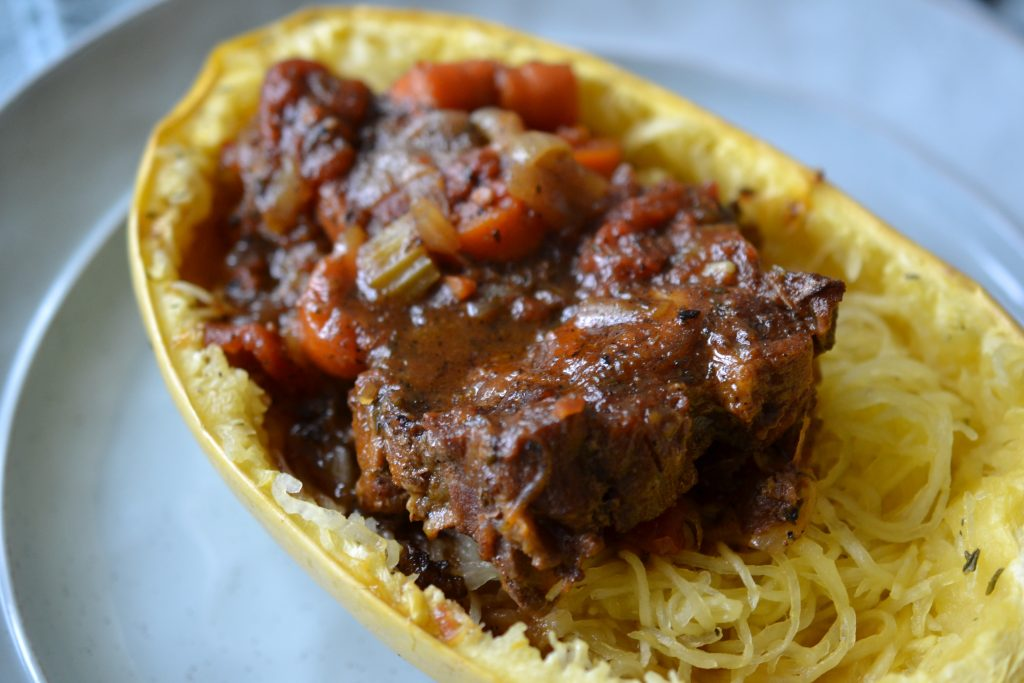Nice close up of oxtail stew in spaghetti squash bowl