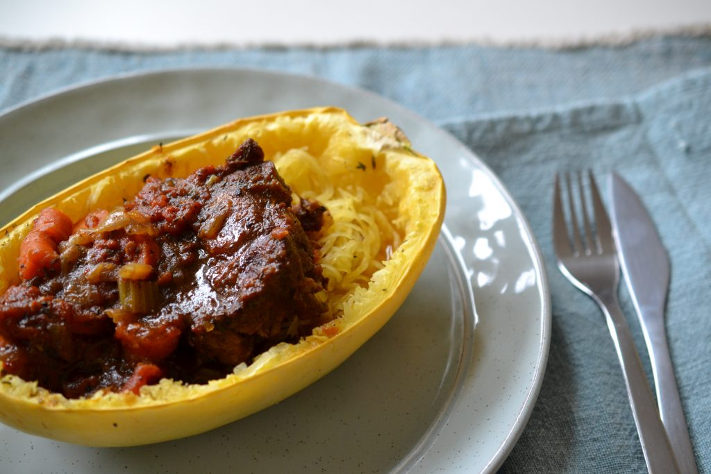 Close up of oxtail stew in spaghetti squash bowl