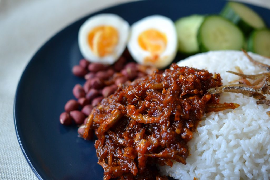 Closer photo of nasi lemak on a plate.