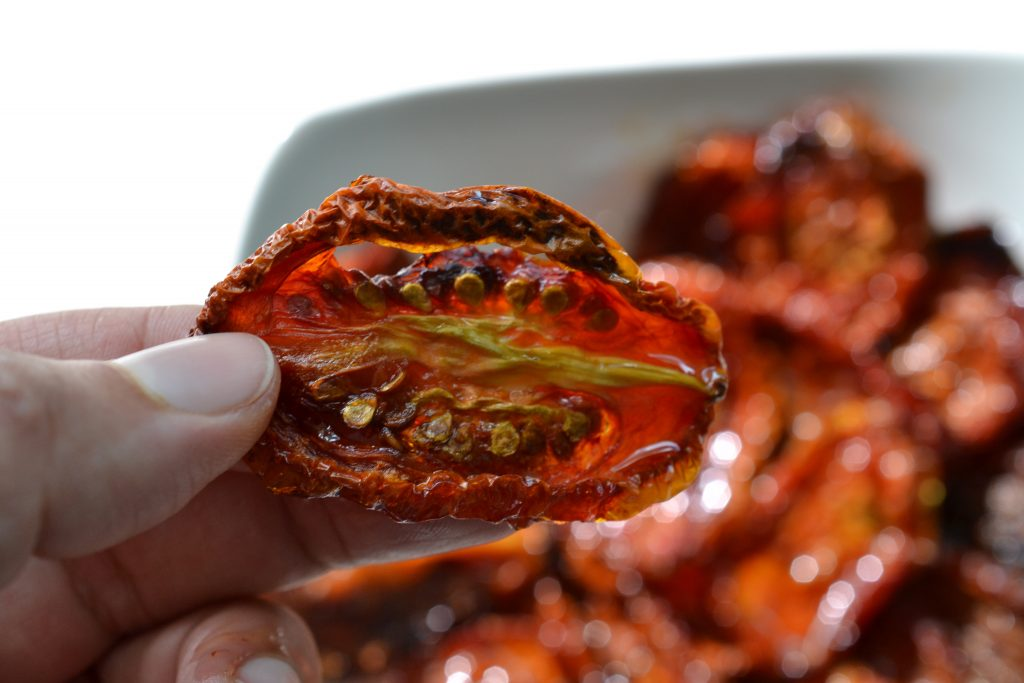 One slice of dried tomato held in author's hand.