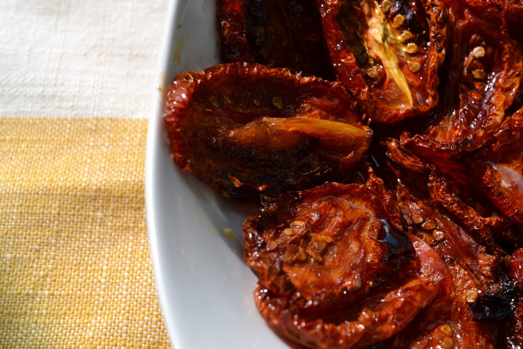 Close-up of bowl of oven-dried tomatoes
