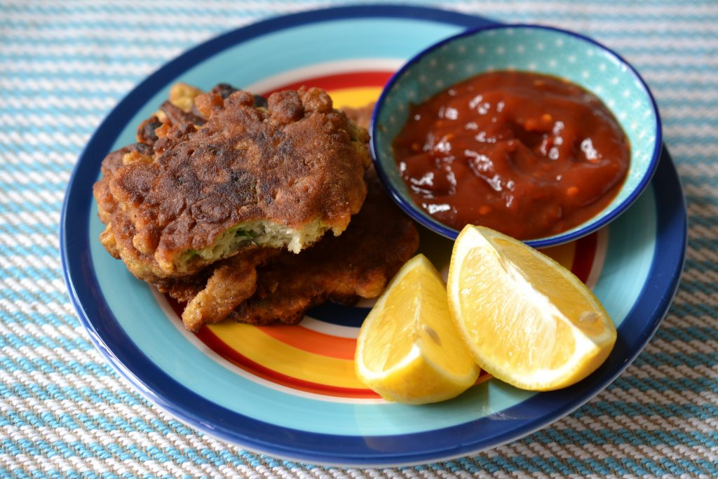 Anchovy fritters with lemon wedges.