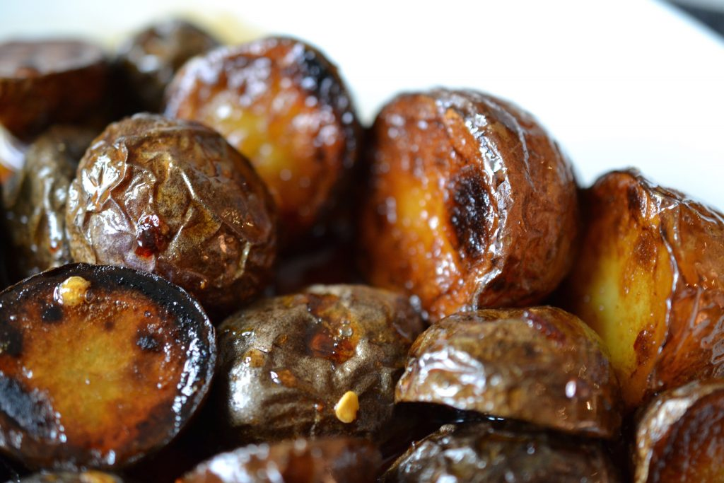 Close up of honey and soy glazed potatoes.