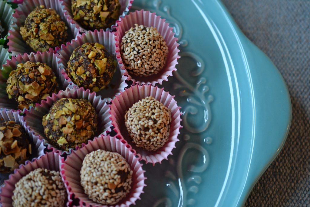 Close up photo of sesame and pistachio energy balls.